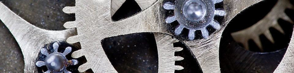 Macro photo of tooth wheel mechanism with ADAPTABILITY concept words